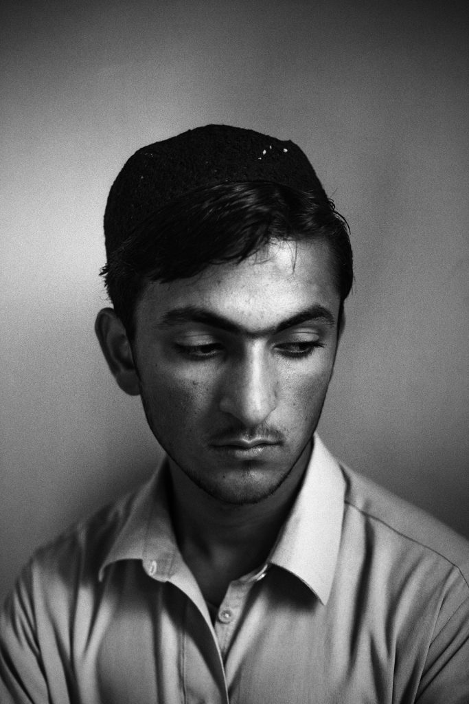 Islamabad, Pakistan, Nov 2013: Salman Khan, 20 years old student from Hisoori village, North Waziristan Agency. On 20/3/2011 he lost his father in a drone Attack. He was at home at the moment of the strike. His father was patecipating to a Girga, (gathering between tribal heads) when at 4:45pm the gathering was hit by the strike. When he heard the sound of the blast he immediately run out of his house and started running in direction of the smoke which was on his uncle house direction. Neighbors confirmed to him that his Uncle house was hit by a drone strike. He was stopped on the way by a line of tribal heads trying to keep people away from the site fearing that a new one could occurr is too many people started gathering in there. Only the day after he came to know that his father also lost his life in the attack but his body got so disfigured that he could not really recognise him. He was left alone with his mother and three younger sisters. They had to sell their shop in order to buy a little piece of land for farming. His area used to be heavely targeted by drones but now since 6 months the situatioation is more calm. He is very distressed and angry whith his own government which do nothing to stop these attacks and is not providing compensation to the victims. Salman added that even people who is not directly involved in the attacks started suffering of several deseases like partial loss of eye sight, skin deseases, reproductive deseases. He suffered of skin deseases for one year. He had painfull pustules all over his body with an high concentration on his back as much as he was not able to sit. He also spoken about the need for education which is affecting his areas also noticing that school often gets shut down because the fear of drones threat.